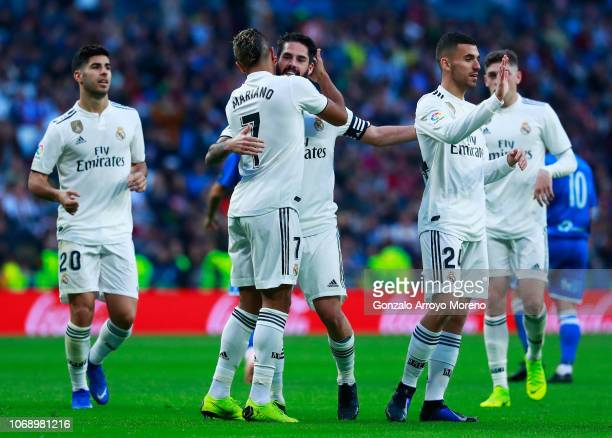 Isco of Real Madrid celebrates after scoring his team's fourth goal with Mariano Diaz and team mates during the Copa del Rey fourth round match...