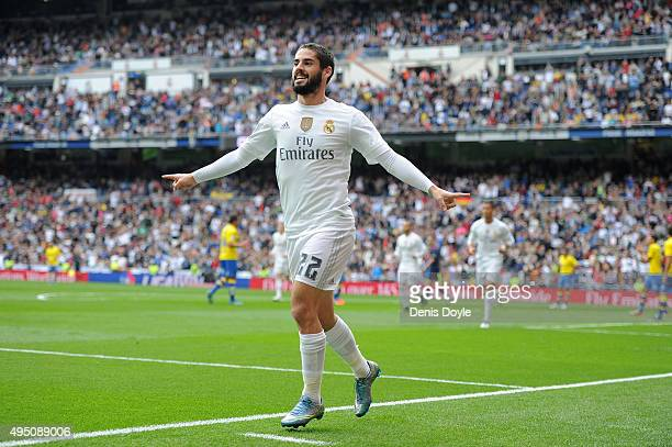 Isco of Real Madrid celebrates after scoring his team's opening goal during the La Liga match between Real Madrid CF and UD Las Palmas at Estadio...