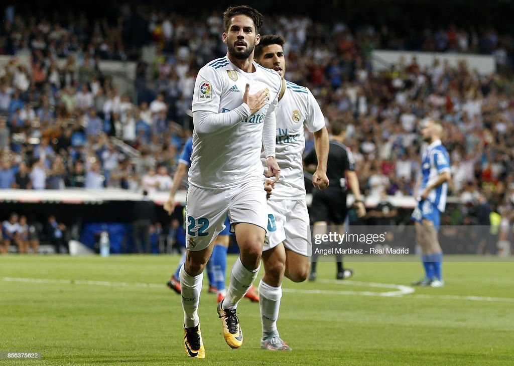 Isco (L) of Real Madrid celebrates after scoring his team's second goal during the La Liga match between Real Madrid and Espanyol at Estadio Santiago Bernabeu on October 1, 2017 in Madrid, Spain.
