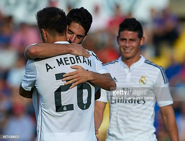 Isco of Real Madrid celebrates after scoring with his teammate Alvaro Medrano during the La Liga match between Levante UD and Real Madrid at Ciutat...