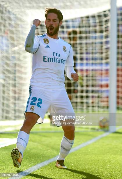 Isco of Real Madrid celebrates scoring his team's first goal during the La Liga match between Girona and Real Madrid at Municipal de Montilivi...