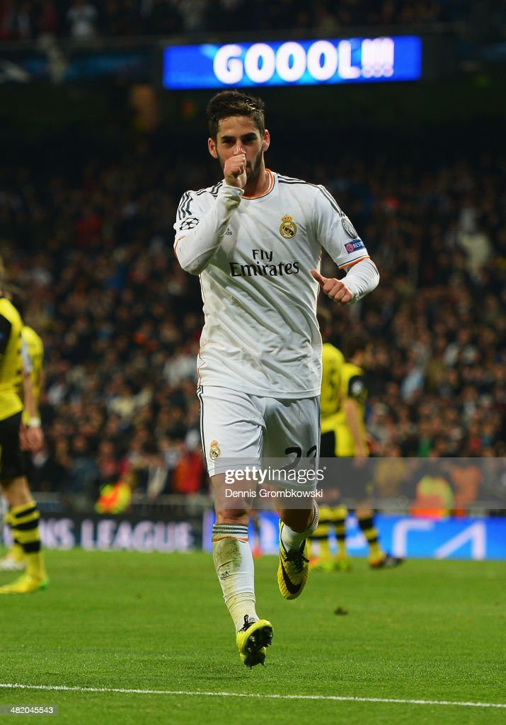 Isco of Real Madrid celebrates scoring his team's second goal during the UEFA Champions League Quarter Final first leg match between Real Madrid and Borussia Dortmund at Estadio Santiago Bernabeu on April 2, 2014 in Madrid, Spain.