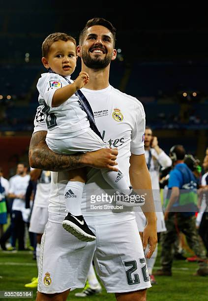 Isco of Real Madrid celebrates victory with his son Isco Alarcon Calderon after winning the Champions League final match between Real Madrid and Club...