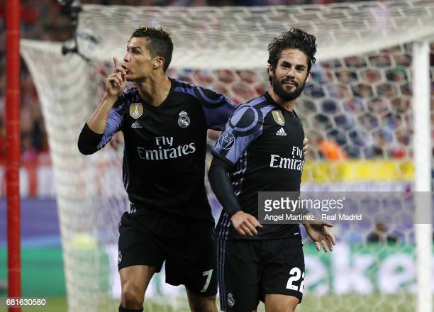 Isco of Real Madrid celebrates with Cristiano Ronaldo after scoring their team's first goal during the UEFA Champions League Semi Final second leg...
