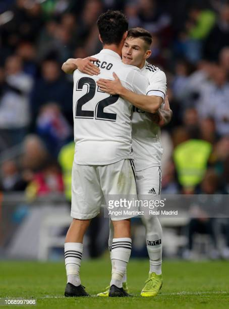 Isco of Real Madrid celebrates with Fran Garcia after scoring their team's sixth goal during the Copa del Rey fourth round second leg match between...