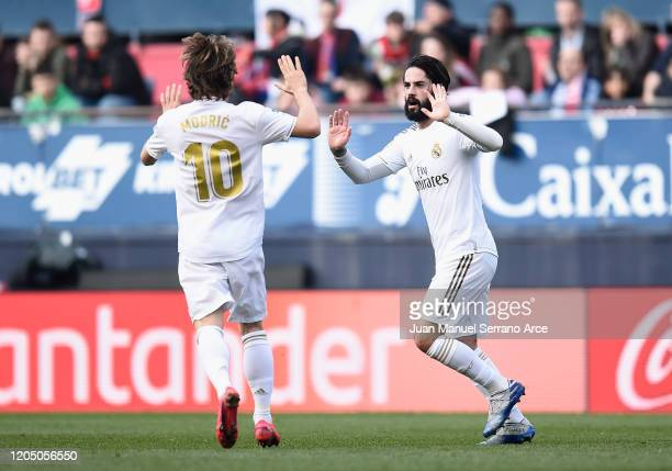 Isco of Real Madrid celebrates with Luka Modric after scoring his team's first goal during the La Liga match between CA Osasuna and Real Madrid CF at...