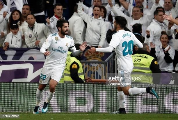 Isco of Real Madrid celebrates with Marco Asensio after a scoring a goal during the Spanish La Liga football match between Real Madrid and Las Palmas...