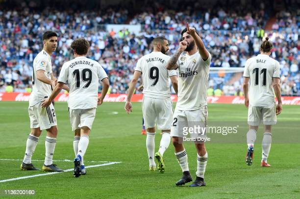 Isco of Real Madrid celebrates with teammates after scoring his team's first goal during the La Liga match between Real Madrid CF and RC Celta de...