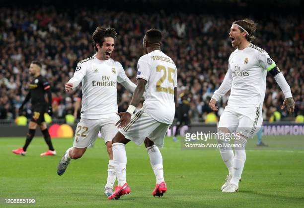 Isco of Real Madrid celebrates with teammates Vinicius Junior and Raphael Varane after scoring his team's first goal during the UEFA Champions League...