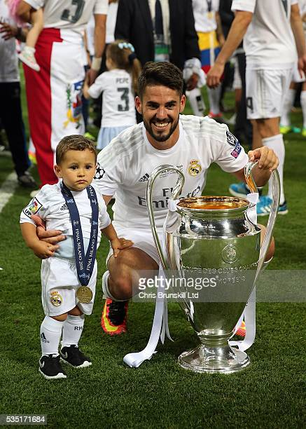 Isco of Real Madrid celebrates with the trophy following the UEFA Champions League Final between Real Madrid and Club Atletico de Madrid at Stadio...