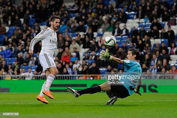 Isco of Real Madrid CF lobs the ball over Inigo Romera to score Real's 2nd goal during the Copa Del Rey Round of 32 Second Leg match between Real...