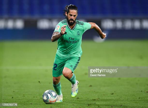 Isco of Real Madrid CF runs with the ball during the Liga match between RCD Espanyol and Real Madrid CF at RCDE Stadium on June 28, 2020 in...