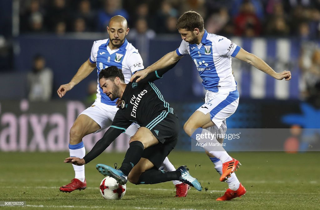 Isco of Real Madrid competes for the ball with Darko Brasanac of Leganes during the Spanish Copa del Rey, Quarter Final, First Leg match between Leganes and Real Madrid at Estadio Municipal de Butarque on January 18, 2018 in Leganes, Spain.