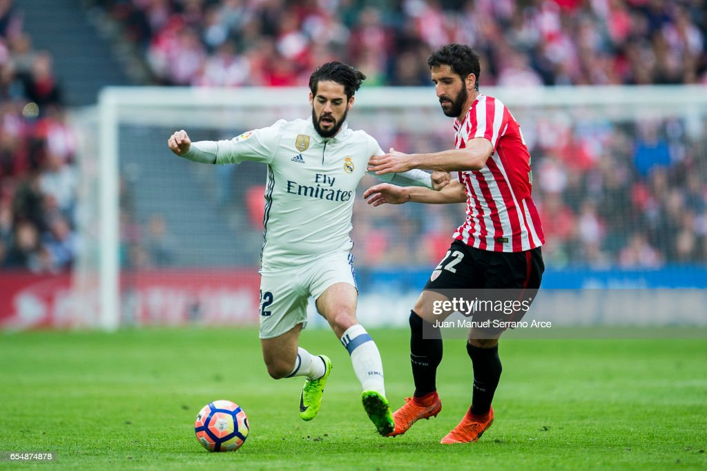 Isco of Real Madrid competes for the ball with Raul Garcia of Athletic Club during the La Liga match between Athletic Club Bilbao and Real Madrid at San Mames Stadium on on March 18, 2017 in Bilbao, Spain.