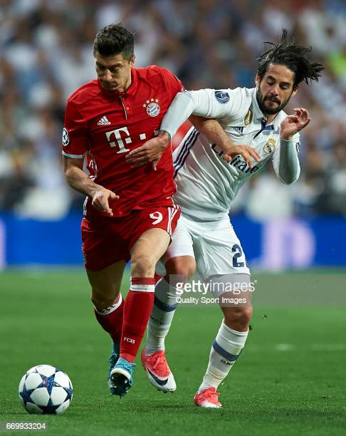 Isco of Real Madrid competes for the ball with Robert Lewandowski of Bayern Muenchen during the UEFA Champions League Quarter Final second leg match...