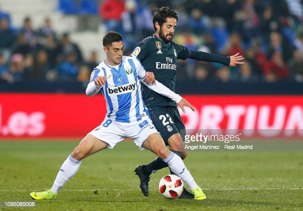 Isco of Real Madrid competes for the ball with Sabin Merino of Leganes during the Copa del Rey Round of 16 match between Leganes and Real Madrid at...