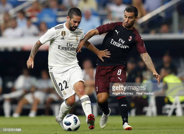 Isco of Real Madrid competes for the ball with Suso of AC Milan during the Trofeo Santiago Bernabeu match between Real Madrid and AC Milan at Estadio...