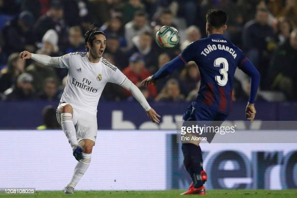 Isco of Real Madrid controls the ball ahead of Tono of Levante UD during the La Liga match between Levante UD and Real Madrid CF at Ciutat de...