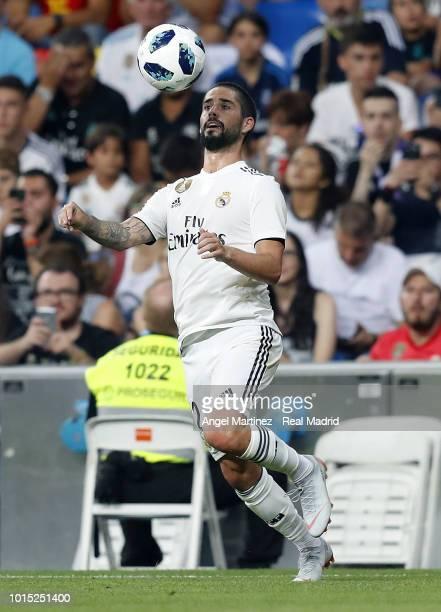 Isco of Real Madrid controls the ball during the Trofeo Santiago Bernabeu match between Real Madrid and AC Milan at Estadio Santiago Bernabeu on...
