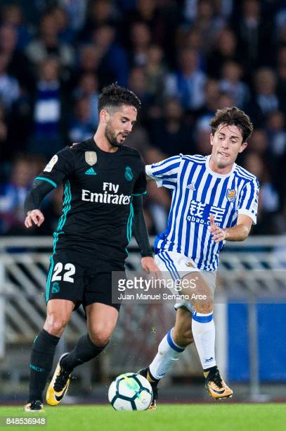 Isco of Real Madrid duels for the ball with Alvaro Odriozola of Real Sociedad during the La Liga match between Real Sociedad de Futbol and Real...