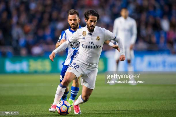 Isco of Real Madrid duels for the ball with Emre colak of RC Deportivo La Coruna during the La Liga match between RC Deportivo La Coruna and Real...