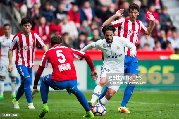 Isco of Real Madrid duels for the ball with Fernando Amorebieta of Real Sporting de Gijon during the La Liga match between Real Sporting de Gijon and...