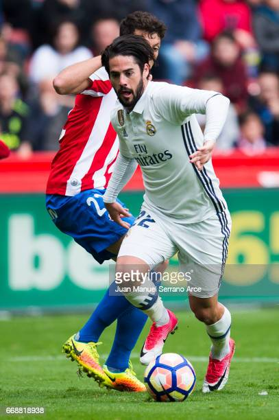 Isco of Real Madrid duels for the ball with Mikel Vesga of Real Sporting de Gijon during the La Liga match between Real Sporting de Gijon and Real...