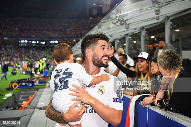 Isco of Real Madrid holding his child celebrates after the UEFA Champions League Final between Real Madrid and Club Atletico de Madrid at Stadio...