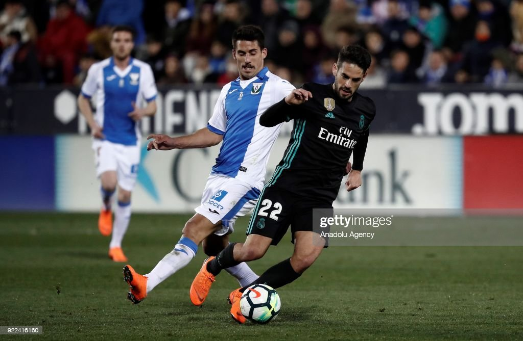 Isco of Real Madrid in action against Gabriel of Leganes during the La Liga football match between Leganes and Real Madrid at the Estadio Municipal Butarque in Madrid, Spain on February 21, 2018.