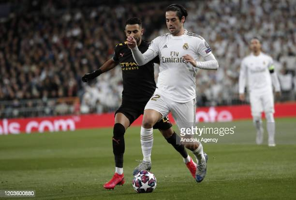 Isco of Real Madrid in action against Riyad Mahrez of Manchester City during the UEFA Champions League round of 16 first leg soccer match between...