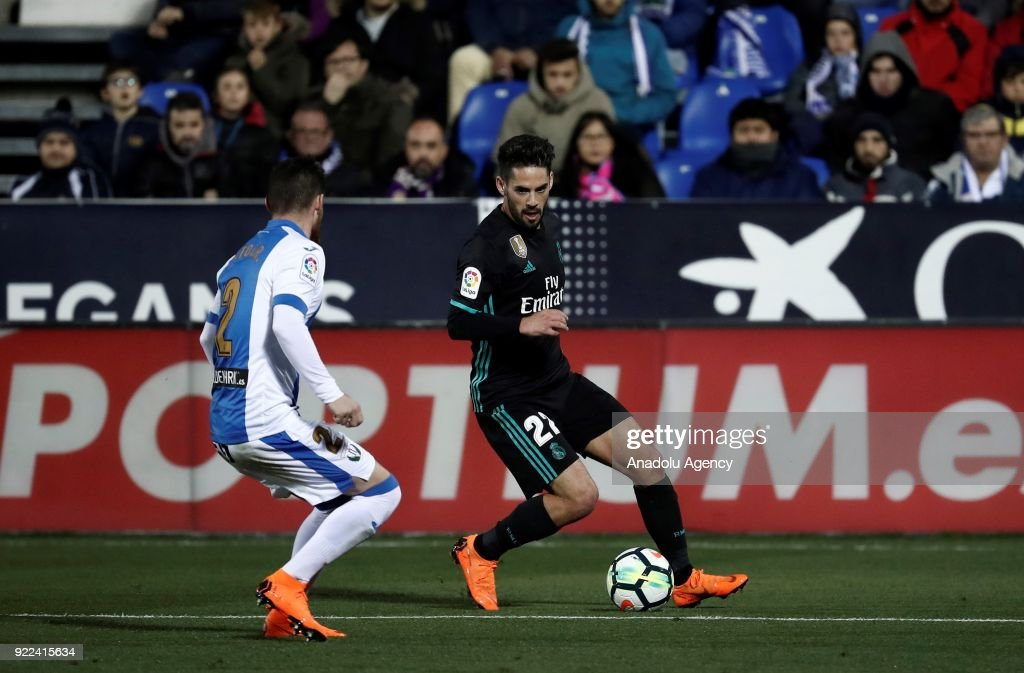 Isco of Real Madrid in action against Tito of Leganes during the La Liga football match between Leganes and Real Madrid at the Estadio Municipal Butarque in Madrid, Spain on February 21, 2018.