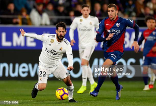 Isco of Real Madrid in action during the La Liga match between SD Huesca and Real Madrid CF at Estadio El Alcoraz on December 9 2018 in Huesca Spain