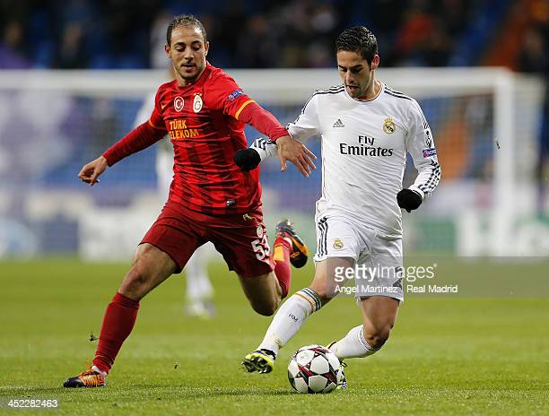 Isco of Real Madrid is challenged by Nordin Amrabat of Galatasaray AS during the UEFA Champions League Group B match between Real Madrid and...