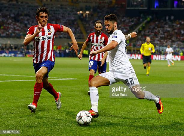 Isco of Real Madrid is challenged by Stefan Savic of Atletico Madrid during the UEFA Champions League Final match between Real Madrid and Club...
