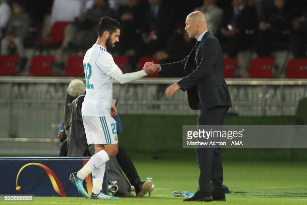 Isco of Real Madrid is substituted by Real Madrid Head Coach / Manager Zinedine Zidane during the FIFA Club World Cup UAE 2017 final match between...