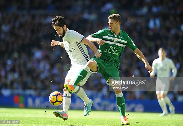 Isco of Real Madrid is tackled by Ruben Perez of CD Leganes during the Liga match between Real Madrid CF and Leganes on November 6 2016 in Madrid...