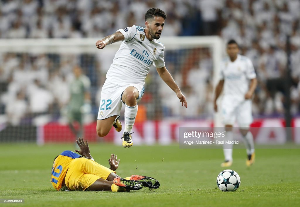 Isco of Real Madrid jumps over Vinicius of APOEL Nikosia during the UEFA Champions League group H match between Real Madrid CF and APOEL Nikosia at Estadio Santiago Bernabeu on September 13, 2017 in Madrid, Spain.