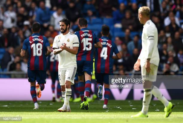 Isco of Real Madrid reacts after Levante score their first goal during the La Liga match between Real Madrid CF and Levante UD at Estadio Santiago...
