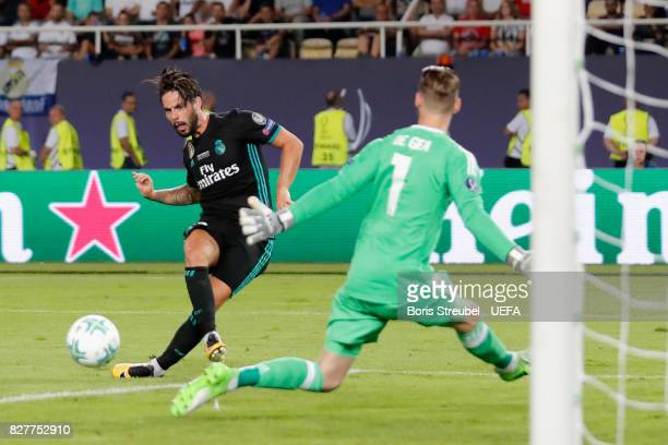 Isco of Real Madrid scores his sides second goal past David De Gea of Manchester United during the UEFA Super Cup final between Real Madrid and...