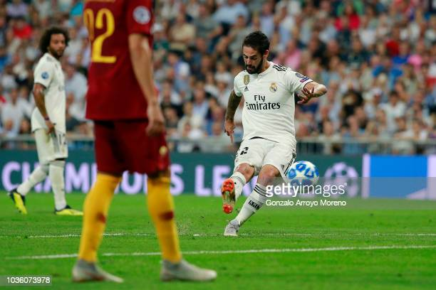 Isco of Real Madrid scores his team's first goal during the Group G match of the UEFA Champions League between Real Madrid and AS Roma at Bernabeu on...