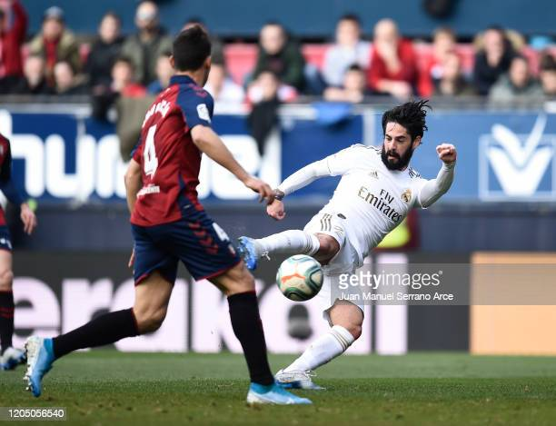 Isco of Real Madrid scores his team's first goal during the La Liga match between CA Osasuna and Real Madrid CF at El Sadar Stadium on February 09,...