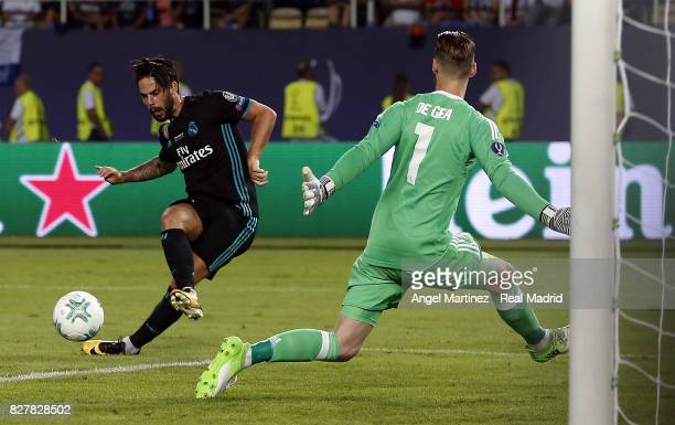 Isco of Real Madrid scores his team's second goal past David de Gea of Manchester United during the UEFA Super Cup match between Real Madrid and...