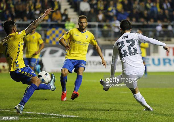 Isco of Real Madrid scores his team's third goal past Cristian Marquez of Cadiz during the Copa del Rey round of 32 first leg match between Cadiz and...