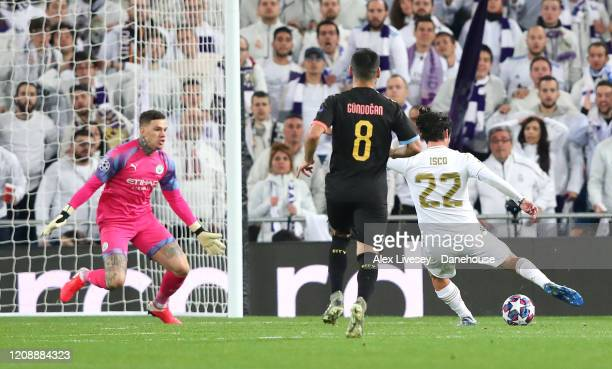 Isco of Real Madrid scores the opening goal during the UEFA Champions League round of 16 first leg match between Real Madrid and Manchester City at...