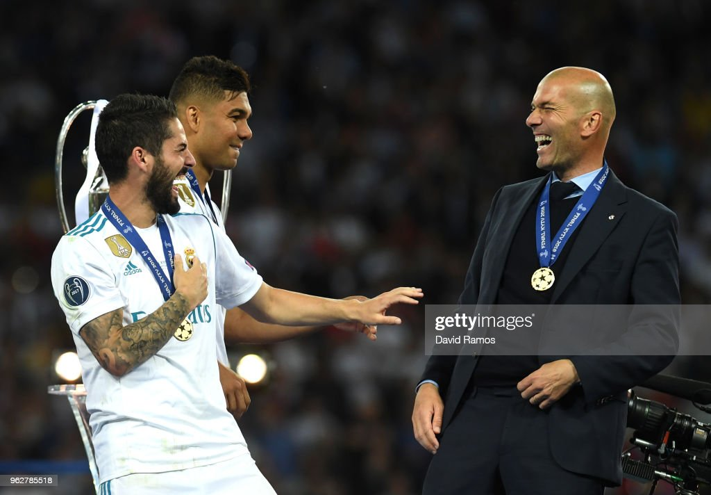 Isco of Real Madrid speaks with Zinedine Zidane, Manager of Real Madrid following their sides victory in the UEFA Champions League Final between Real Madrid and Liverpool at NSC Olimpiyskiy Stadium on May 26, 2018 in Kiev, Ukraine.