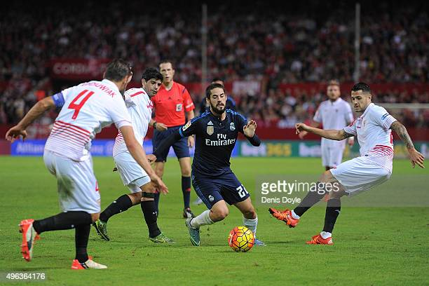 Isco of Real Madrid takes on Grzegorz Krychowiak of Sevilla FC during the La Liga match between Sevilla FC and Real Madrid CF at Estadio Ramon...
