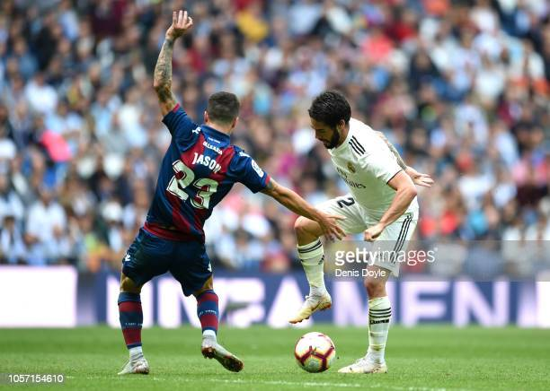 Isco of Real Madrid takes on Jason of Levante during the La Liga match between Real Madrid CF and Levante UD at Estadio Santiago Bernabeu on October...