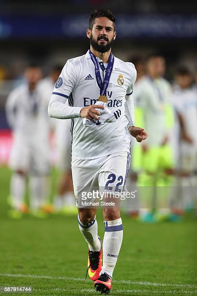 Isco of Real Madrid with his winners medal following his side's 32 extra time win during the UEFA Super Cup match between Real Madrid and Sevilla at...
