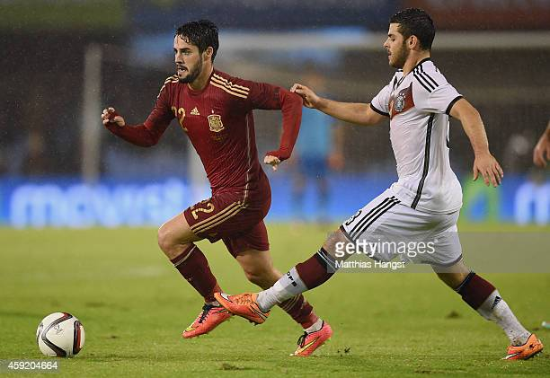 Isco of Spain and Kevin Volland of Germany compete for the ball during the International Friendly match between Spain and Germany at Estadio Balaidos...
