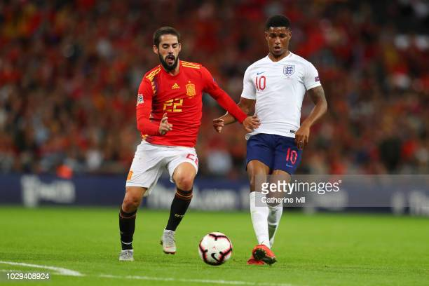 Isco of Spain and Marcus Rashford of England battle for the ball during the UEFA Nations League A group four match between England and Spain at...